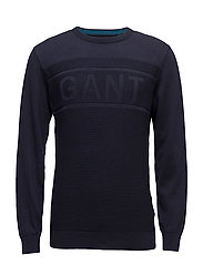 O1. GANT LOGO TEXTURE CREW - EVENING BLUE