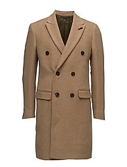 Long double breasted coat in wool quality with contrast inte
